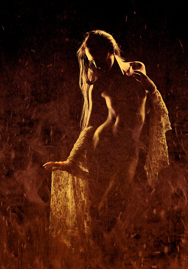 Photograph of a nude with textures added to look like fire
