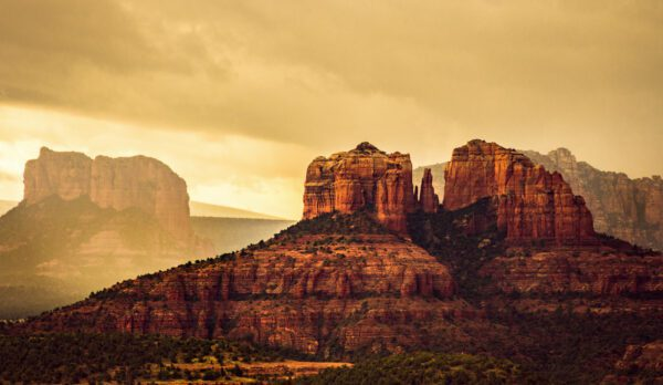 A dramatic photo of Chapel Rock and Courthouse Butte in Sedona, AZ