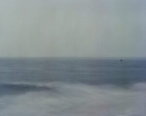An abstract photo of a buoy in the waves