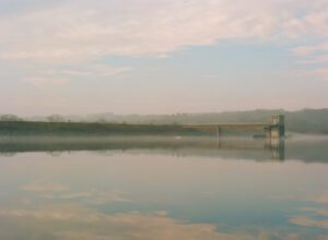 A photograph of haze and fog at the Lake Galena dam.