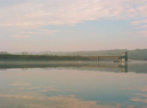 A photograph of haze and fog at the Lake Galena dam.