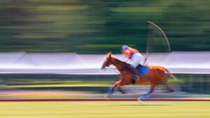 A photograph of a polo athlete about to hit the ball.