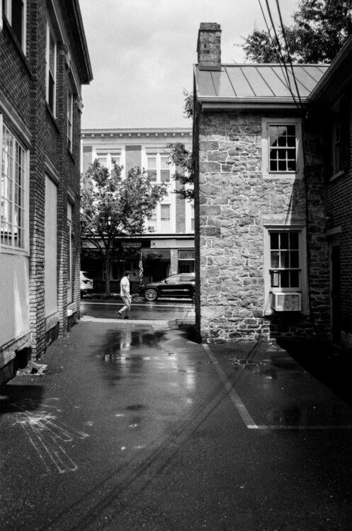 Man walking past an alley in Doylestown