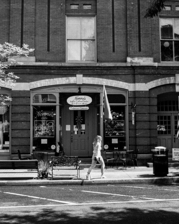 Girl walking past Nonna's in Doylestown
