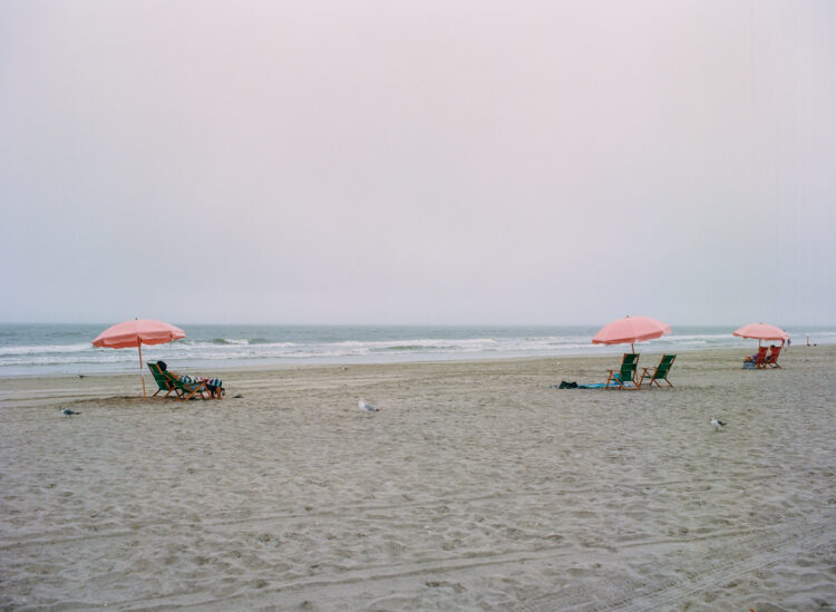 Umbrellas on the beach on a cloudy day