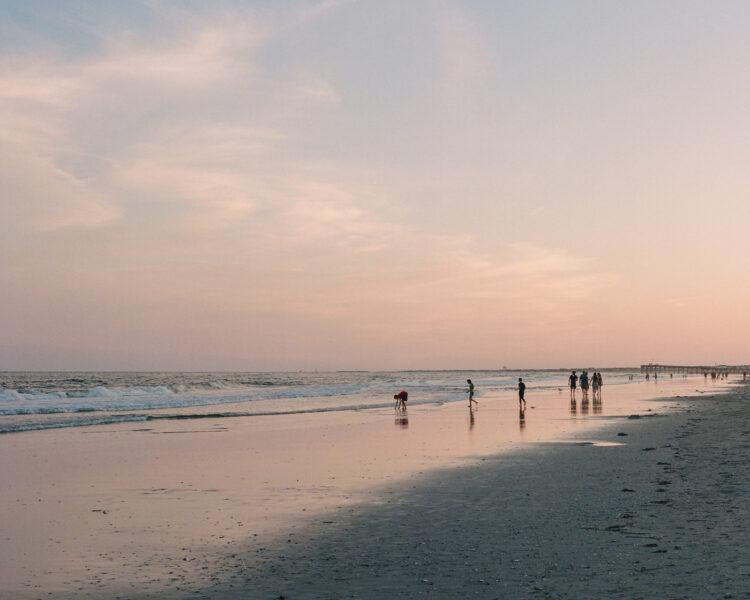 Beachgoers at dusk