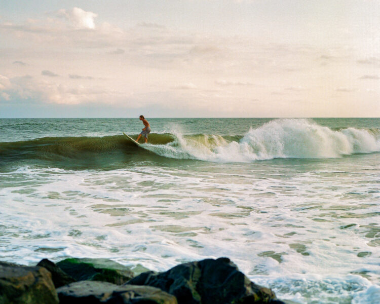 A surfer on the waves