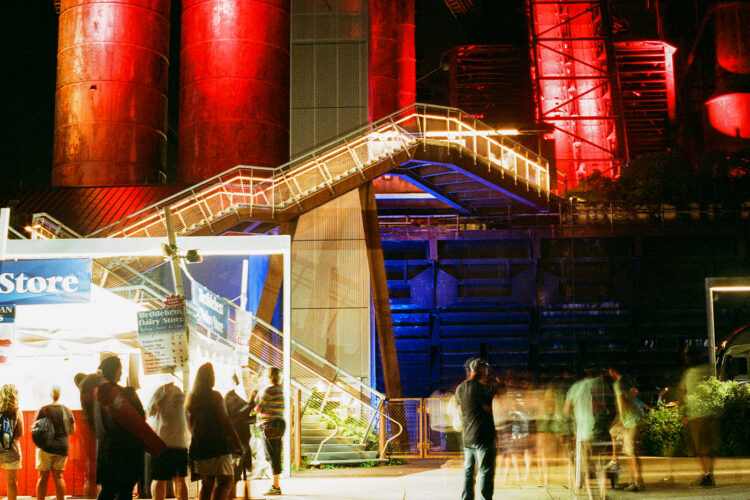 Abstraction of people moving under the Steel Stacks