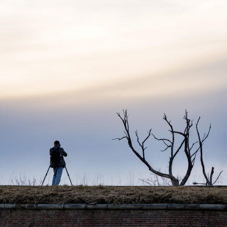 Photographer on a hill at Fort Mifflin