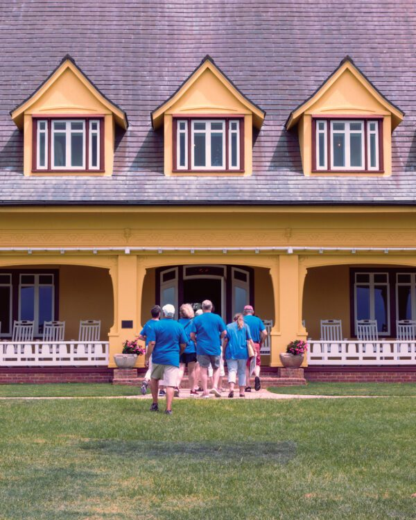 Blue people entering a yellow building, Whales Head, NC
